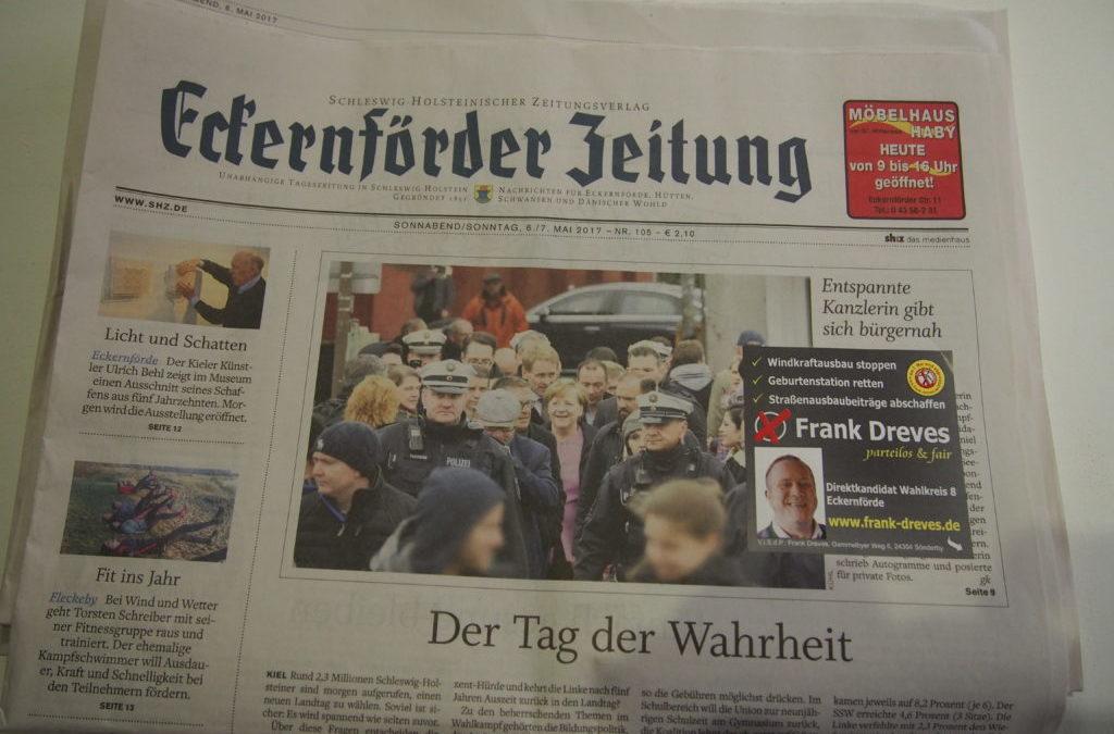 Wenn der Dreves der Merkel eine klebt:10.000 Aufkleber auf der Titelseite der EZ von heute